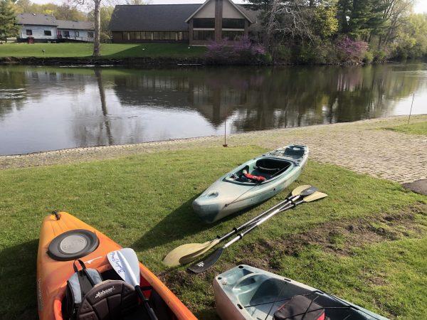 Kayaks on riverbank