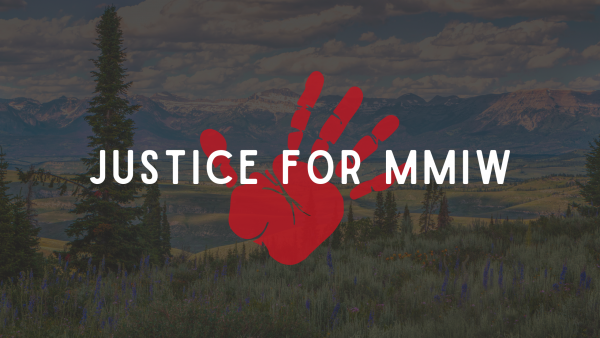 Justice for MMIW written over a red handprint on a Wyoming landscape